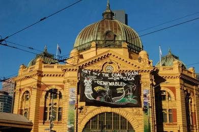 Flinders Street Station banner drop http://quitcoal.org.au/get-off-the-coal-train-and-on-track-with-renewables-denis/